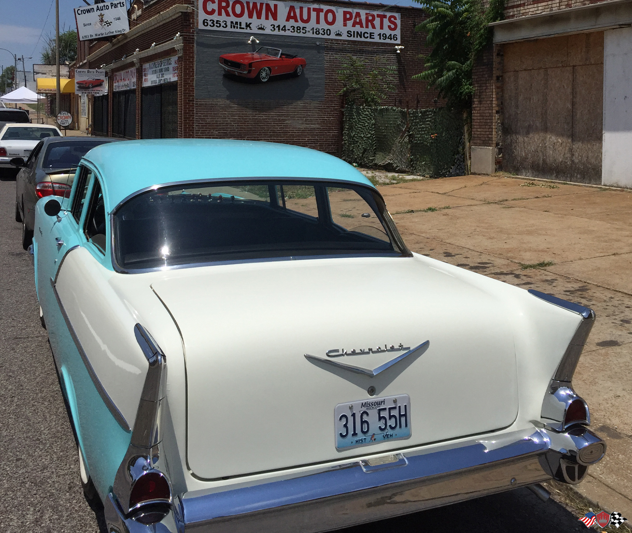 1957 chevy 210 out front of Crown Auto Parts